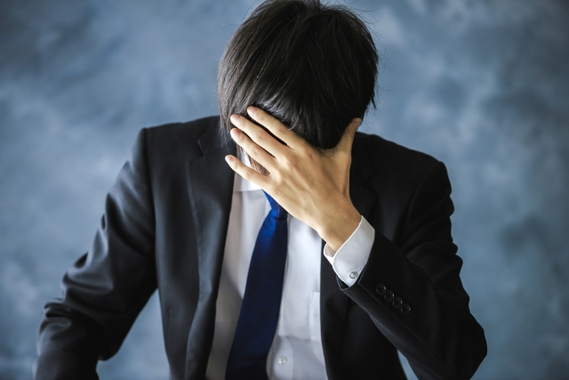 株式で失敗した男性