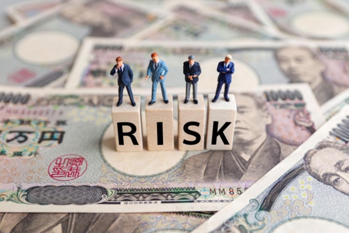 リスクのブロックと人形